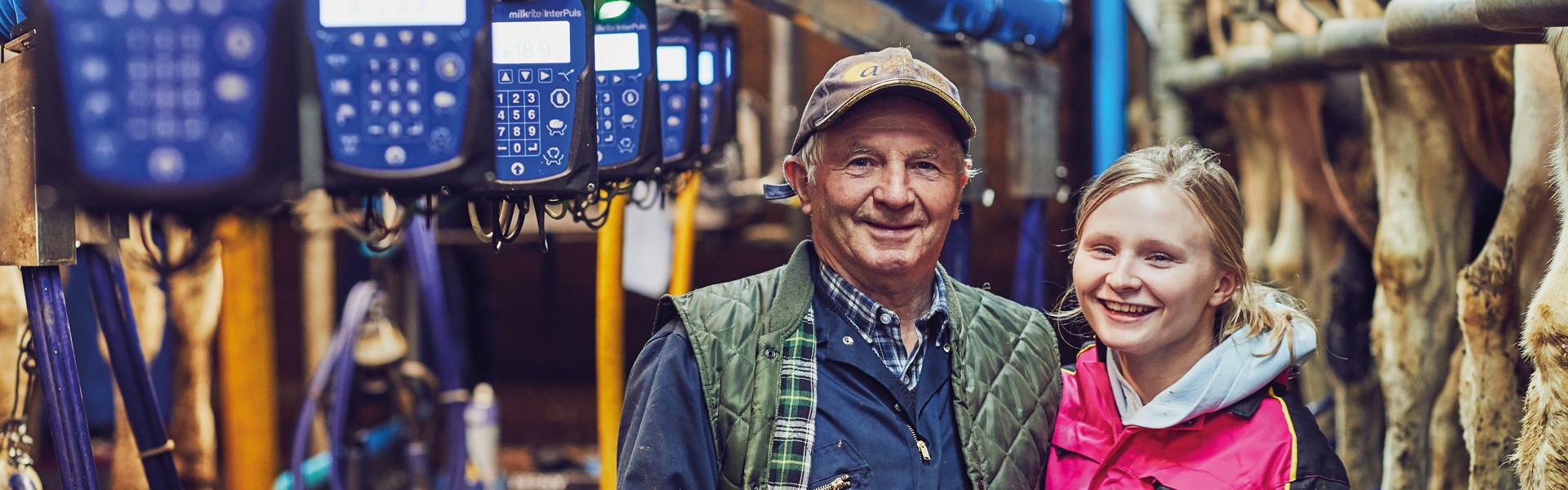 Happy Farmers next to iMilk600 Electronic Milk Meters